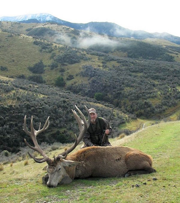 Andy and Kay Vail take a Silver Medal Red Stag at High Peak Game Estate